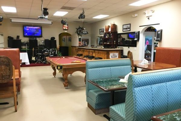 Enjoy a separate room just for your event with a bar, stage for entertainment and a pool table!