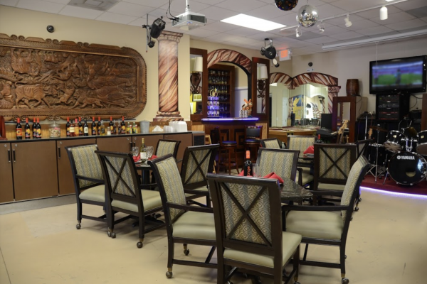 Enjoy a separate room just for your special event with a full bar and a stage for entertainment.